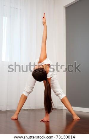 portrait of woman doing flexibility exercise - stock photo