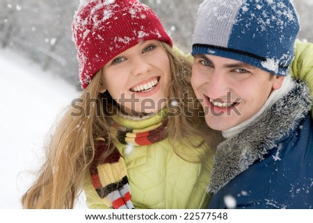 Portrait of woman embracing her boyfriend in the park - stock photo