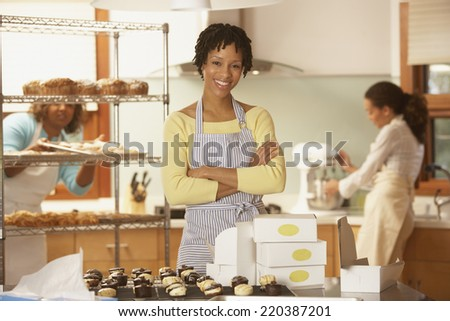 Portrait of woman employees at bakery - stock photo