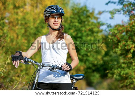 Portrait of woman enjoying a bicycle ride