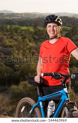 Portrait of Woman Enjoying Recreational Mountain Biking - stock photo