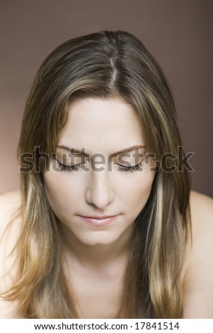 Portrait of woman, eyes closed - stock photo