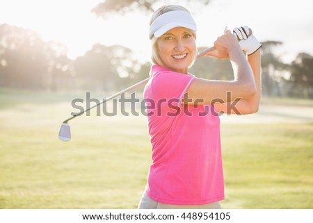Portrait of woman golfer smiling on the field