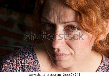 portrait of woman half face in the shadow  - stock photo