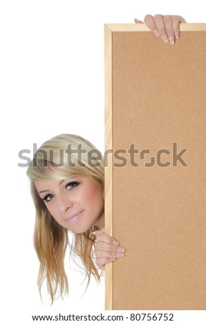 Portrait of woman holding a blank corkboard