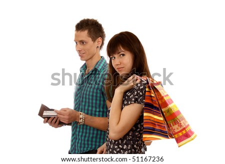 Portrait of woman holding color shopping bags - stock photo