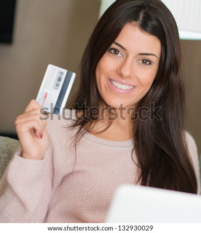 Portrait Of Woman Holding Credit Card, Indoors - stock photo
