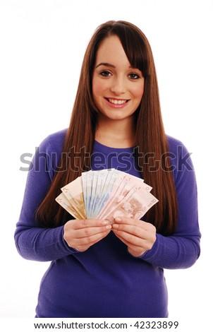 Portrait of woman holding euros - stock photo