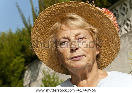 portrait of woman in age of in hat - stock photo