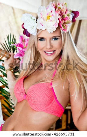 Portrait of woman in bathing swim posing on tropical beach - stock photo