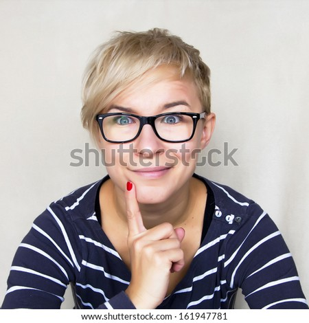 portrait of woman in black glasses having an idea - stock photo