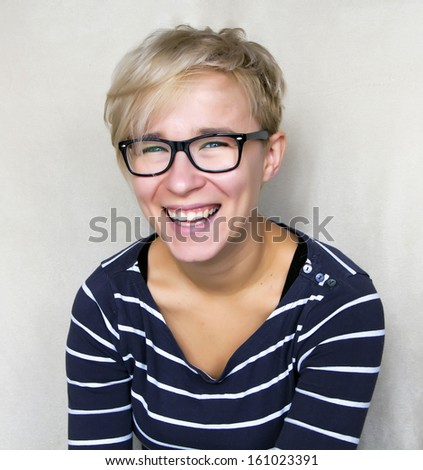 portrait of woman in black glasses laughing - stock photo