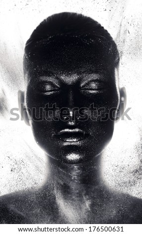 portrait of woman in black paint with dust