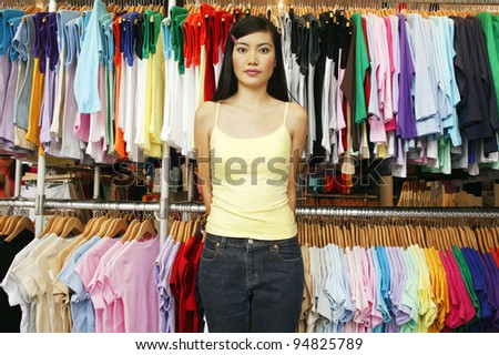 Portrait of woman in clothing store - stock photo