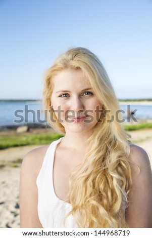 Portrait of woman in dress and long hairs - stock photo
