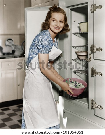 Portrait of woman in kitchen - stock photo