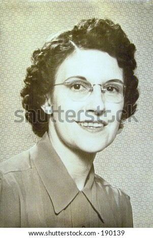 Portrait of woman in late thirties or early forties. Wearing glasses and simple makeup. - stock photo