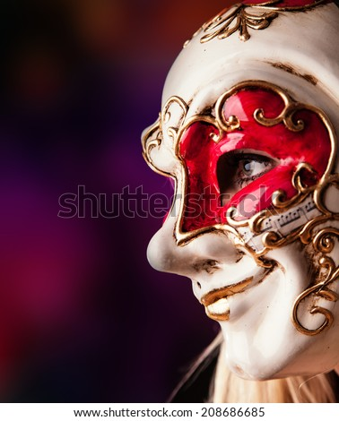 Portrait of woman in red costume and colored venice mask