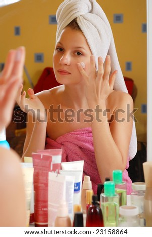 portrait of woman in towels near the mirror - stock photo