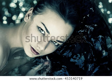 Portrait of woman in water