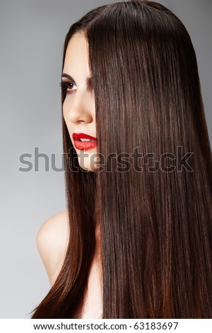 Portrait of woman model with red lips. Fashion hairstyle with smooth long female hair. Cosmetics and make-up. - stock photo