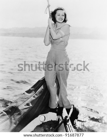 Portrait of woman on boat - stock photo