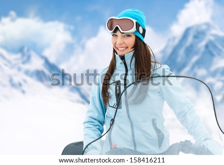Portrait of woman on snowmobile.Concept of snow sport and healthy lifestyle - stock photo