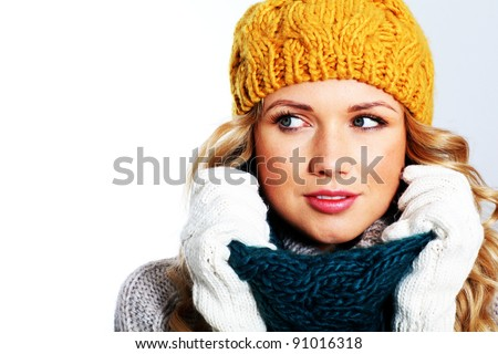 Portrait of woman on white background wearing woolen accessories - stock photo