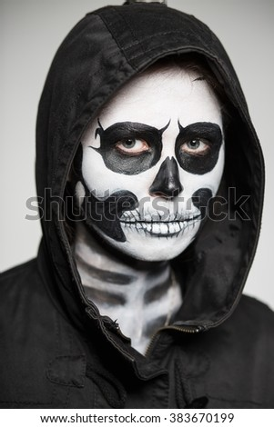 Portrait of woman painted like a skeleton for Halloween. Monochrome