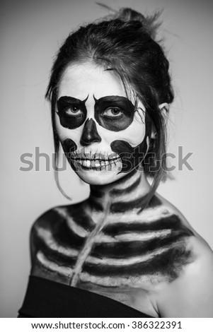 Portrait of woman painted like a zombie. Monochrome - stock photo