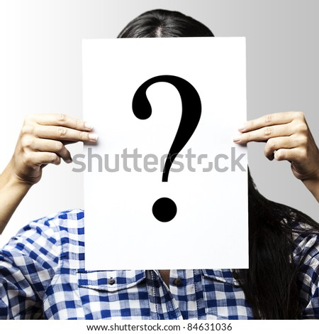 portrait of woman peaking behind of interrogation symbol over blue background - stock photo