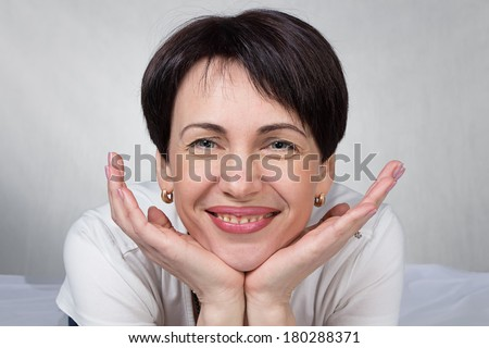 Portrait of woman - photo portrait with gray background - stock photo