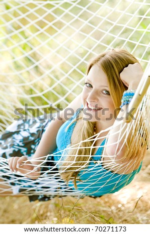 portrait of woman resting in hammock - stock photo