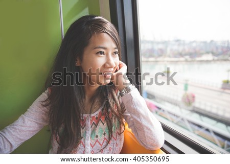 portrait of Woman riding in a bus and looking happy