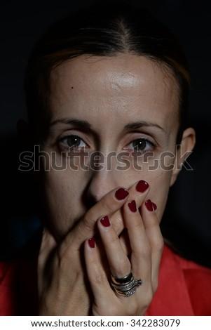 Portrait of woman, sad, silent, victim - stock photo