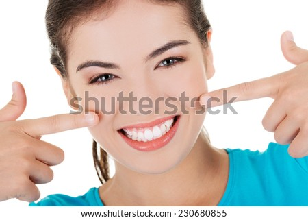 Portrait of woman showing her teeth. - stock photo