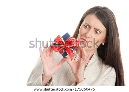 Portrait of woman showing unwanted gift isolated on white background. What is it?