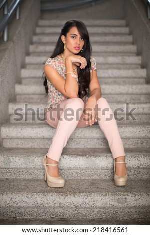 Portrait of woman sitting on office stairs