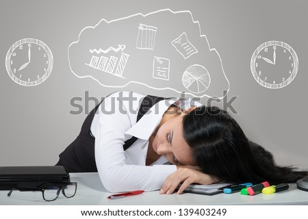 Portrait of woman sleeping on her workplace with the drawn clocks and charts over her head - stock photo