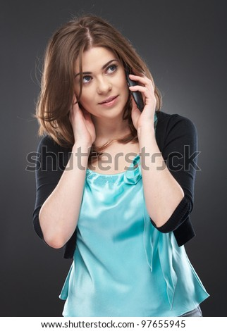 Portrait of woman speaking on the phone. Isolated on gray background - stock photo