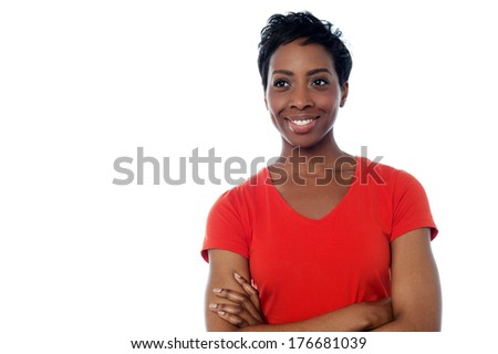 Portrait of woman standing with arms crossed - stock photo