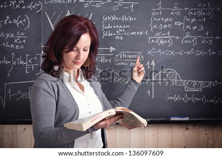 portrait of woman teacher and blackboard background