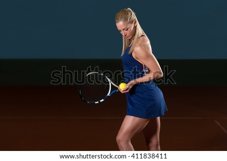 Portrait Of Woman Tennis Player With Racket Ready To Hit A Tennis Ball - stock photo