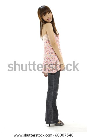 Portrait of Woman the side standing in full length - stock photo