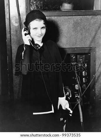 Portrait of woman using telephone