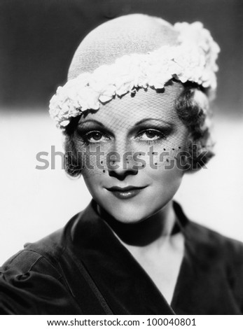 Portrait of woman wearing hat with veil - stock photo