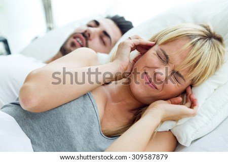 Portrait of woman who can not sleep because her husband snores. - stock photo