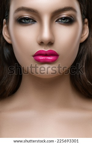 Portrait of woman with a big lips close-up - stock photo