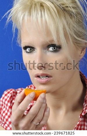 Portrait of woman with a clementine