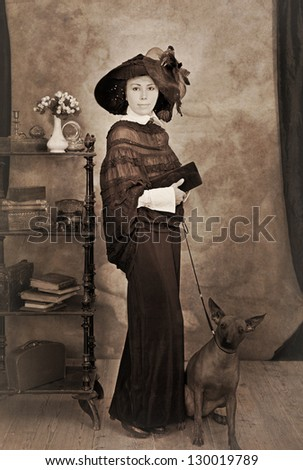 Portrait of woman with a dog. Intentional 1900's style post processing emulation. - stock photo